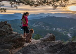 woman hikes with dog