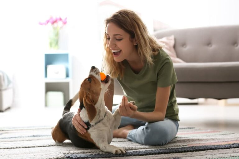 woman bonding with dog at home