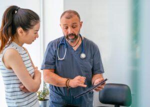 veterinarian speaks with client