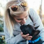 Woman hugging French bulldog