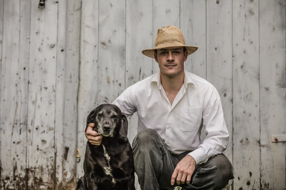 Old fashioned photo of man and dog