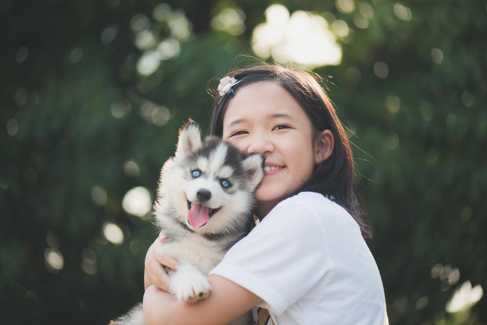 Japanese girl holding dog