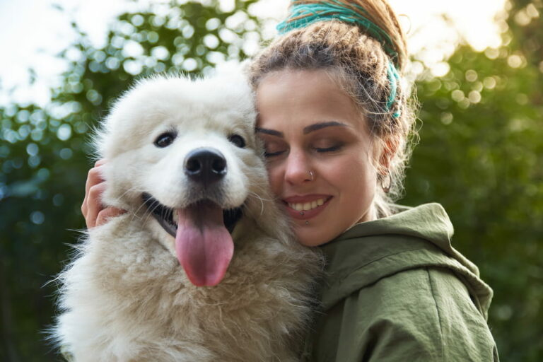 Woman cuddling big fluffy dog