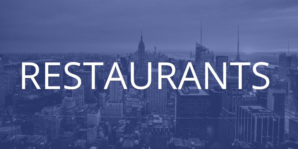 A New York skyline with a blue tint over it, the text introduces the restaurants section of the article